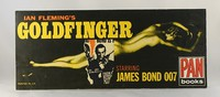 Goldfinger | Pan | Movie. Shop display board.  Part of the marketing campaign.