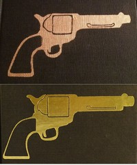 The Man With The Golden Gun with fake gun stamped on the cover