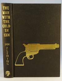 The Man With The Golden Gun with the gun stamped on the cover