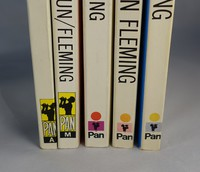 Spines of the Pan white series, ones on the right show fading
